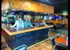 """Howling Dog Saloon owner Jodi Reverts and bartender Mellinda Smith say the new state restrictions on bar seating is affecting the sociology of human connections in their establishments. """"I had one of my regulars tell me, 'I don't think I can go to the bar anymore. I don't want to sit at a table by myself to get something to eat.' And he's not the only one."""" She said some of her patrons living alone seek companionship at the counter."""