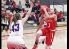 Luverne guard Brooklynn Ver Steeg puts up a shot in front of H-BC's Sam Moser during Friday's season-opening basketball game in Luverne.