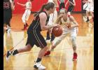 Brooklynn Ver Steeg pressures an Edgerton player during Monday's girls' basketball game in Edgerton.
