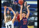 Grace Bundesen casts up a shot over R-T-R's Hailey Muenchow during Tuesday's game in Hills.