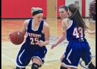H-BC's Abby Knobloch (25) takes advantage of a pick set by Taryn Rauk (43) to drive the lane during Saturday's game in Hills.