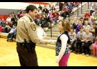 Luverne Elementary School fifth-grader Egypt Forrest gets a congratulatory handshake from Deputy Mike DeJong before receiving her DARE diploma. Eighty-six diplomas were given out during Monday's DARE Class of 2015 graduation.