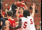 Luverne sophomore Isaiah Bartels releases a shot in traffic during Tuesday's home loss to Worthington.