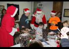 Santa and Mrs. Claus make an appearance at Hardwick's Santa Claus Day Saturday in the Arthur Moeller American Legion Post 478. They help out with crafts during Santa's Workshop.
