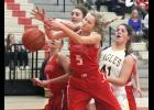 Luvern freshman Elizabeth Wagner fights for a rebound during Monday's home loss to Southwest Christian.