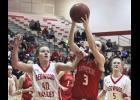 Luverne senior Hailey Remme grabs one of her seven rebounds during Monday's 45-30 home win over RWV.