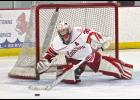 Sophomore goalie Shaid Shearer makes one of his 61 saves during Friday's 8-1 home loss to St. Cloud Cathedral.
