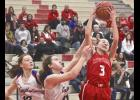 Brooklynn Ver Steeg snares a rebound during Friday's 82-18 home win over HL-O-F.