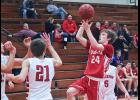 Luverne junior Brayden Jacobsma releases a one-handed shot in front of Edgerton's Marcus Vander Lugt during Friday's boys' basketball game in Luverne. Jacobsma netted 16 points during a 75-44 win.