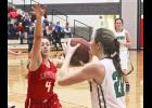 Luverne senior Joci Oe applies defensive pressure on Pipestone's Carmen Skyberg during Tuesday's game in Luverne.