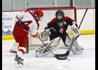 Luverne freshman forward Rylee Gee fires a shot at Worthington goalie Bailey Kruse during Thursday's game at the Blue Mound Ice Arena.