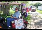 Rich Leenderts represents the Hills American Legion and Auxiliary on their 100-year anniversary float.