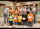 Fifteen grade seven and older 4-H'ers receive Fab 15 awards. They are (front, left) Andrea Severtson, Moriah Flanagan, Hannah Kruse, Joni Vander Beek, Kristopher Severtson, (back row) Matthew Raak, Ryleigh Beers, Erica Lysne, Trevor Mente, Christian Kruse, Dylan Mente and Andrew Raak. Missing are Michael Kinsinger, McKenna Westphal and Joanna Westphal.